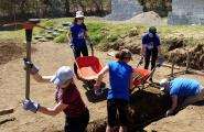 Students working digging a trench